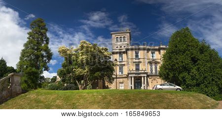 EXETER DEVON UK - July 11 2016: University of Exeter. Reed Hall. Many of green trees. Summer. Day.
