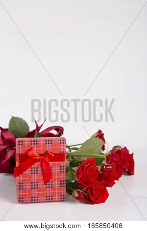 Bouquet Of Red Roses With Red Gift Box On White Background