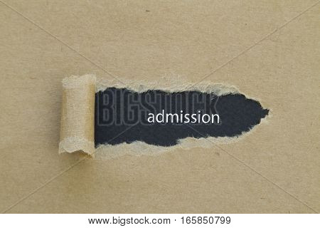 Admission word written under brown torn paper.
