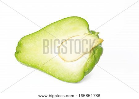 Chayote (Sechium edule) halved fruit isolated against white background