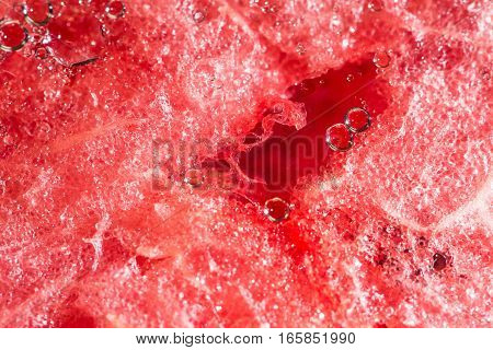 Red watermelon background. Detailed closeup. Abstract texture.