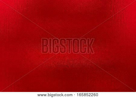 Red metallic foil paper texture background. Close up