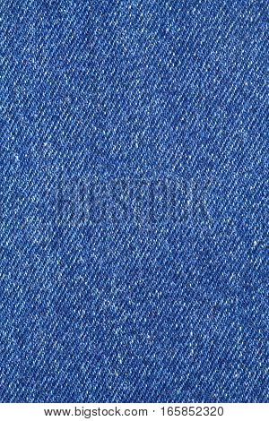 Blue denim jeans cloth diagonal background pattern vertical view closeup