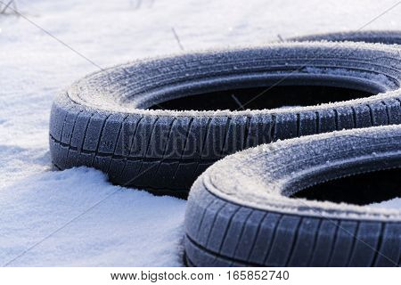 Winter Tires On Snow On Sunny Winter Freezing Day
