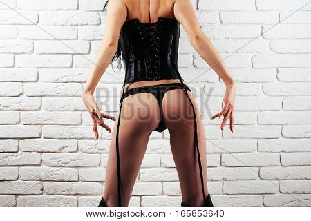 Female Buttocks In Sexy Leather Lingerie