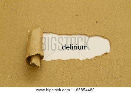 delirium word written under torn paper .