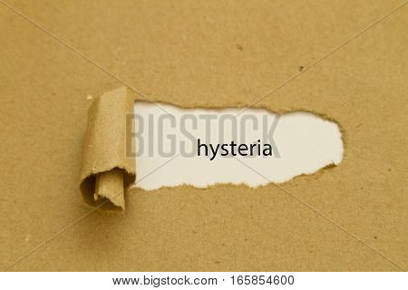 hysteria word written under torn paper .