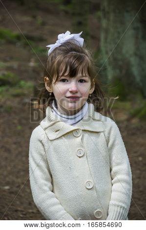close-up of little girl in spruce forest