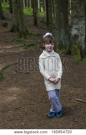 a little girl in the spruce forest