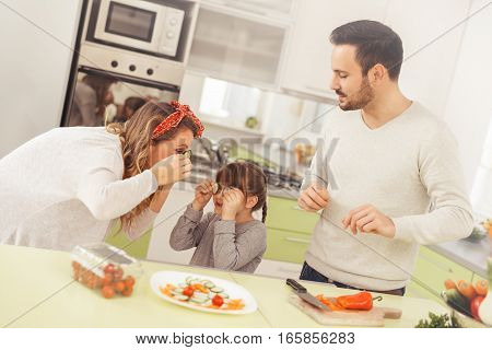 Happy family preparing lunch together in the kitchen