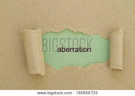 aberration word written under torn paper .