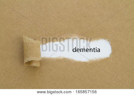 dementia word written under torn paper .