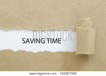 Saving Time word written under torn paper.