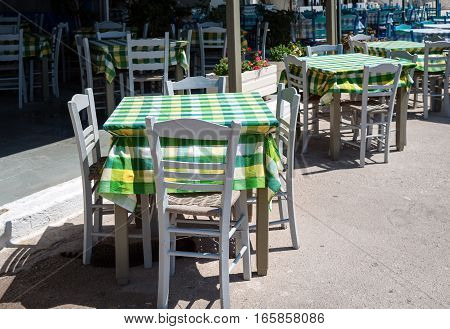 Wooden chairs and tables at traditional Greek tavern