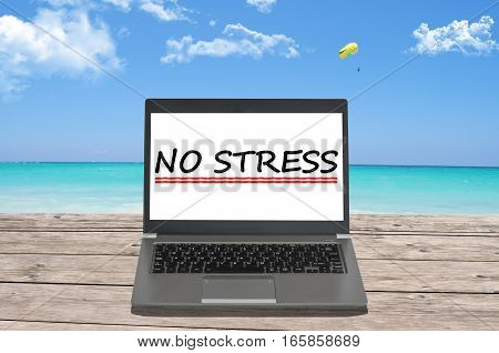 No stress text with notebook on a beach