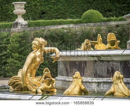 Versailles, France - June 2016: Fountain fragment in the park of Versailles palace