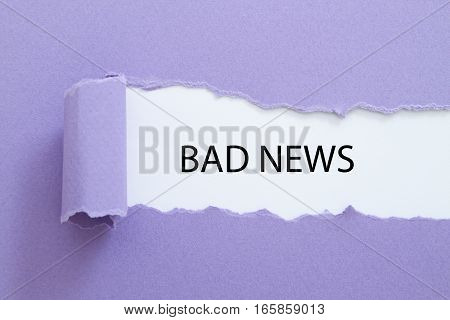 BAD NEWS word written under torn paper.