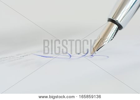 Sign a contract or agreement with a pen