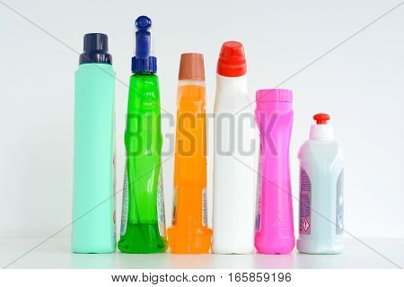 Many bottles of cleaning solutions isolated on white background
