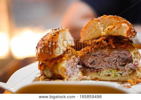 Fresh delicious beef burger close-up on white background