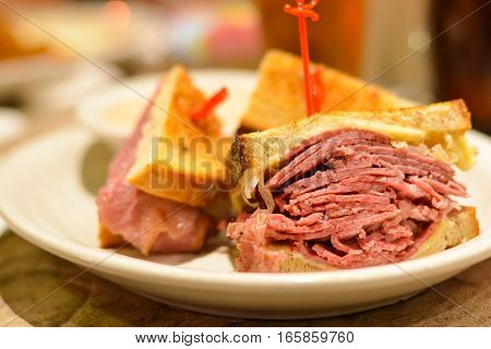 Corned beef pastrami and toast sandwich close up