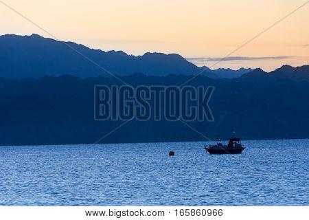 Boat At Sunrise In Gulf Of Aqaba