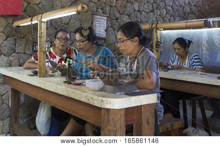Bali Indonesia September 9th 2016: balinese lady making jewellery