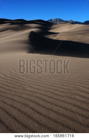 Ripples of sand and shadows at the Great Sand Dunes National Park near Alamosa, Colorado in spring