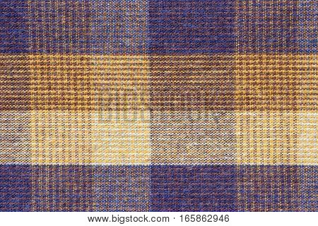Blue and yellow plaid fabric close up. Background and texture