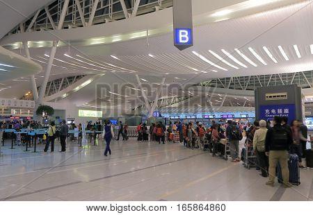 HANGZHOU CHINA - NOVEMBER 6, 2016: Unidentified people travel at Hangzhou international airport.
