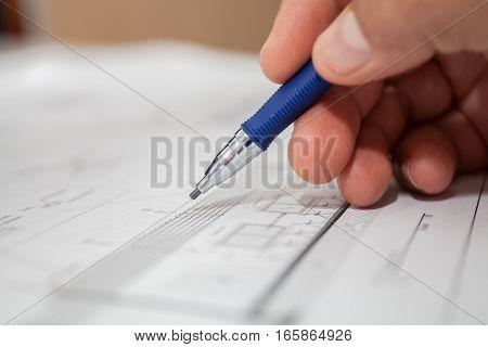 construction engineer draws pencil selective focus stock photo