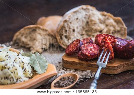 Farmer's Breakfast. Sausage Sour Cabbage and Bread. Raw Ingredients.