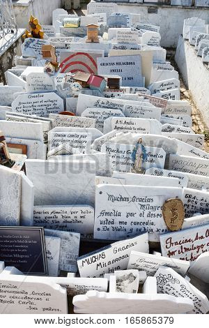 HAVANA CUBA - JULY 21 2016: Plaques next to the tomb of Amelia Goyri de la Hoz La Milagrosa (The Miraculous One). The tomb is a symbol of motherhood love to children.