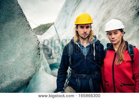 Team of Scientists Examining a Glacier, looking at the ice.