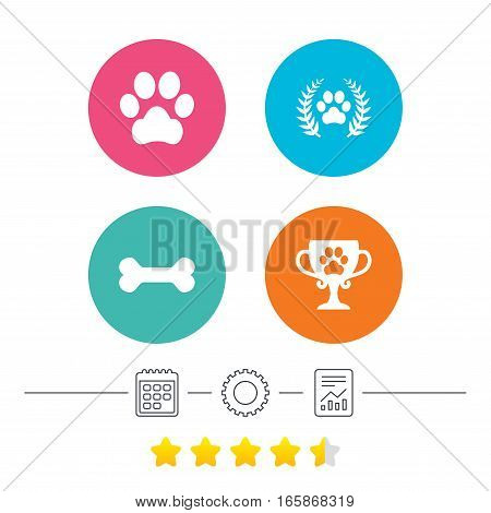 Pets icons. Dog paw sign. Winner laurel wreath and cup symbol. Pets food. Calendar, cogwheel and report linear icons. Star vote ranking. Vector