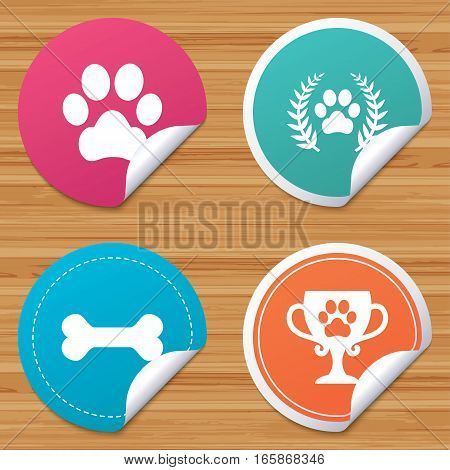 Round stickers or website banners. Pets icons. Dog paw sign. Winner laurel wreath and cup symbol. Pets food. Circle badges with bended corner. Vector