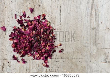 Decorative Rose Petals On White Wood