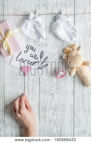 birth of child - baby shower concept on wooden background top view