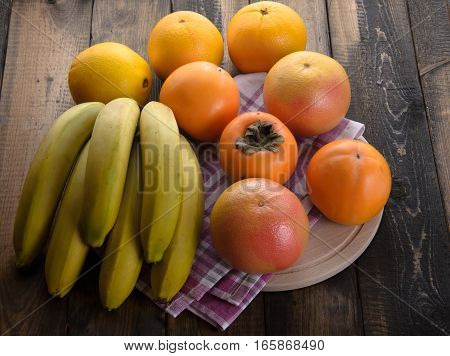 fresh fruits on a wooden table, close-up.