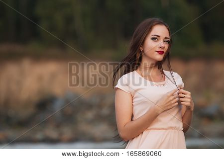 Young beautiful girl on a sandy beach