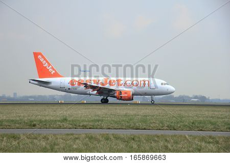 March 24th 2015 Amsterdam Schiphol Airport G-EZDZ easyJet Airbus A319-111 landing on Polderbaan Runway