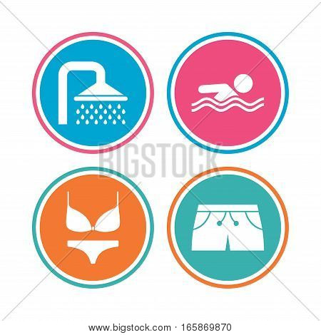 Swimming pool icons. Shower water drops and swimwear symbols. Human swims in sea waves sign. Trunks and women underwear. Colored circle buttons. Vector