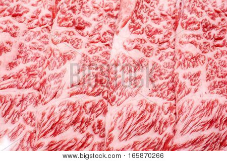 Lined Wagyu beef marbled meat in vertically arranged