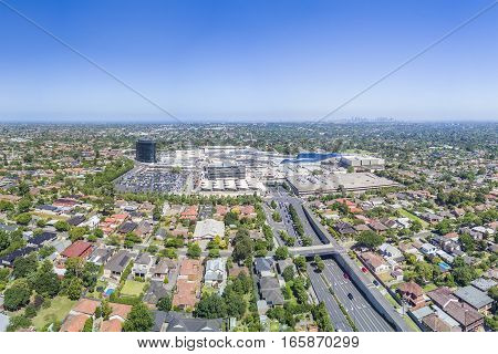 Melbourne, Australia - Jan 19, 2017: Aerial view of Chadstone Shopping Centre, with view of Melbourne CBD in the background. The mall is the biggest in Australia.