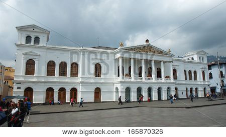 Quito, Pichincha / Ecuador, January 19 2017: People walking in front of National Theater Sucre in the historical center of the city of Quito.