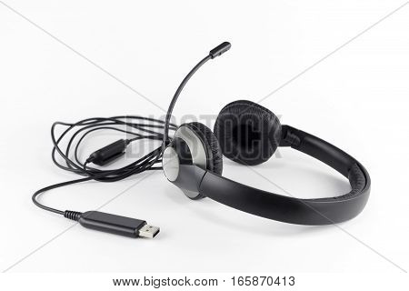 Stereo Headset with Microphone and USB Connector on White Background