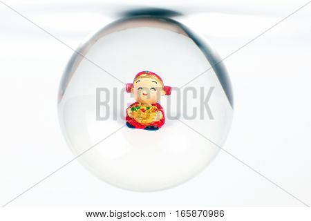 Chinese doll through glass spear cny on white background