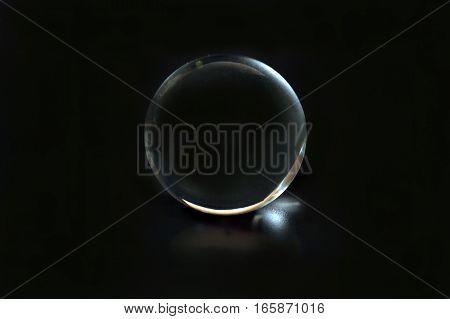 Glass spear ball globe transparent on black background