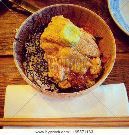 Japanese uni sashimi over rice and seaweed