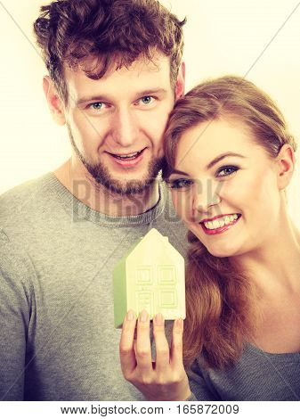 Youthful Pair With House Model.
